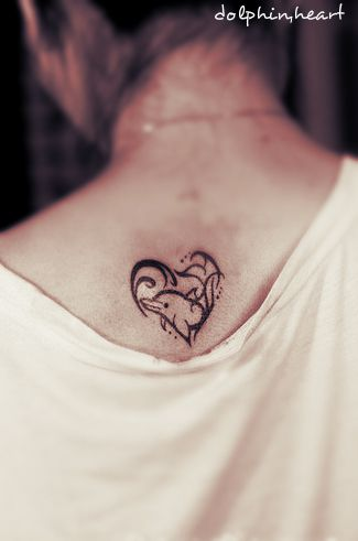 A dolphin tattoo design in the shape of a heart while combining with the waves #dolphin #tattoo
