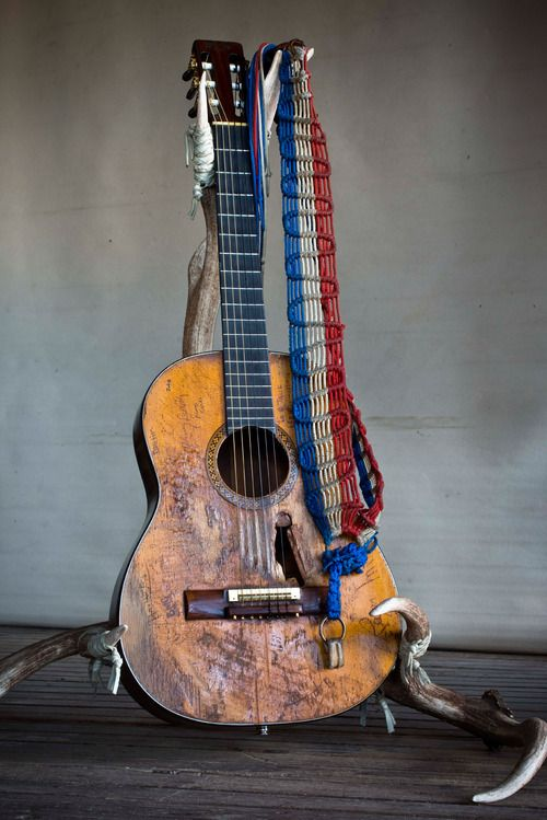 Willie Nelson's guitar and antler guitar stand.
