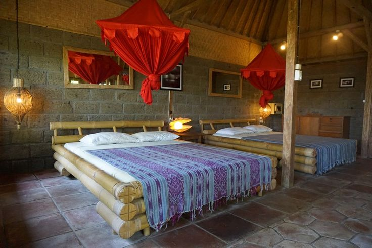 BADING KAYU Located in front of the surf with a view towards Balian river mouth. Bading Kayu is a large open plan room with 2 doubles beds and 1 single bed. All guests share one hot water bathroom and there is a second toilet for convenience