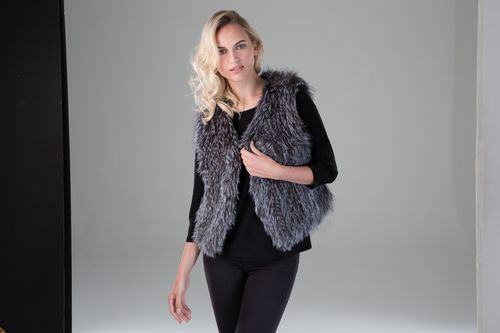 Luxurious and plush, Surell Accessories women's fox fur knit vest pairs with any look whether casual or formal. With a simple collar, this women's fur vest makes the perfect cozy layer this winter.