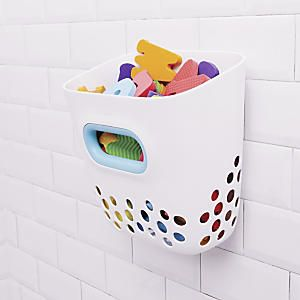 OXO Tot Bath Toy Storage Bin: This multi-tasking bathtub organizer holds up to 5 lbs. of bath toys, yet hangs out of the way on the tub wall to save space. It doubles as a scoop for fast, fun toy pick-up, and its ample drainage holes ensure toys dry fast. Once kids outgrow tub toys, they can use it to hold their shampoos and toiletries...