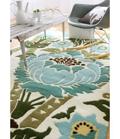 I do love Amy Butler, and this rug is sweet.