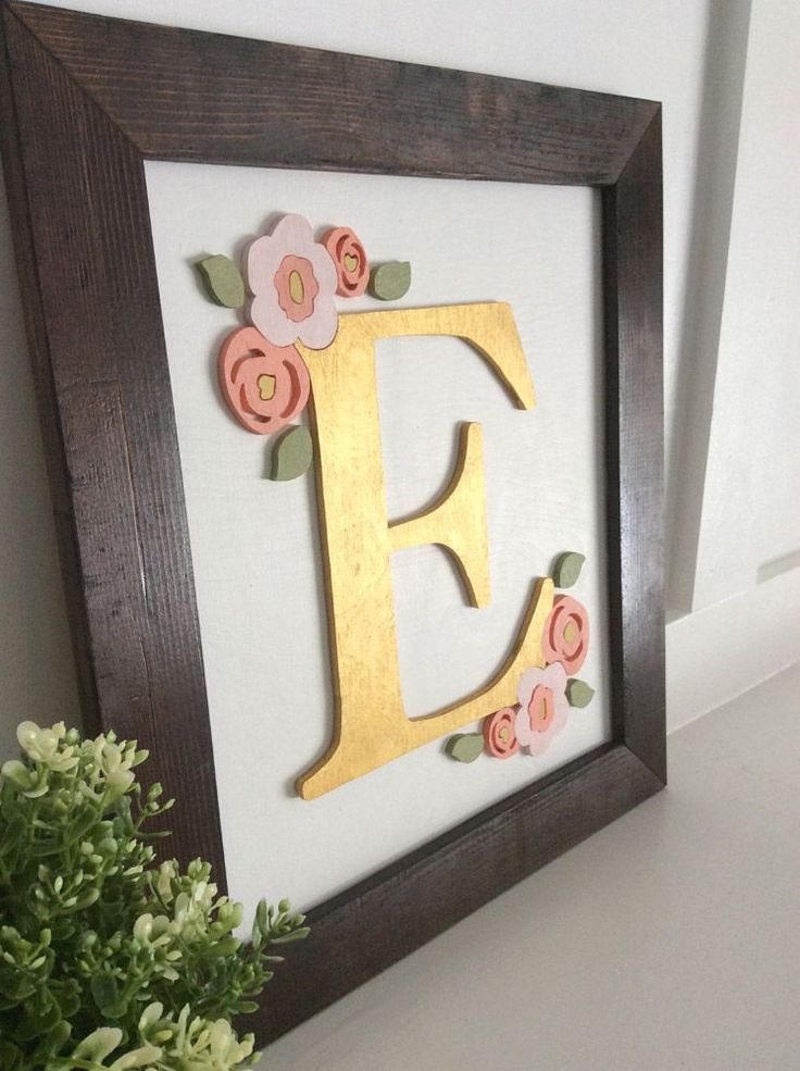 Baby Initial Sign - Custom Wood Cutout Plaque. Our baby initial signs are a beautiful way to add a custom piece to your home or nursery! Featuring a large capital letter surrounded by a hand-made floral design, these solid-wood, hand-made plaques are perfect for a baby shower gift or any baby nursery!