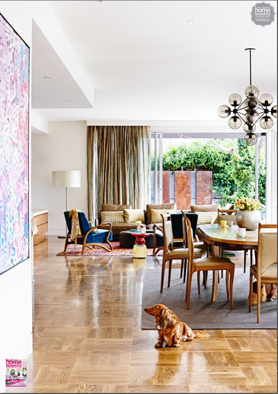 This spacious open plan living - light fitting and down lights gives it pizazz