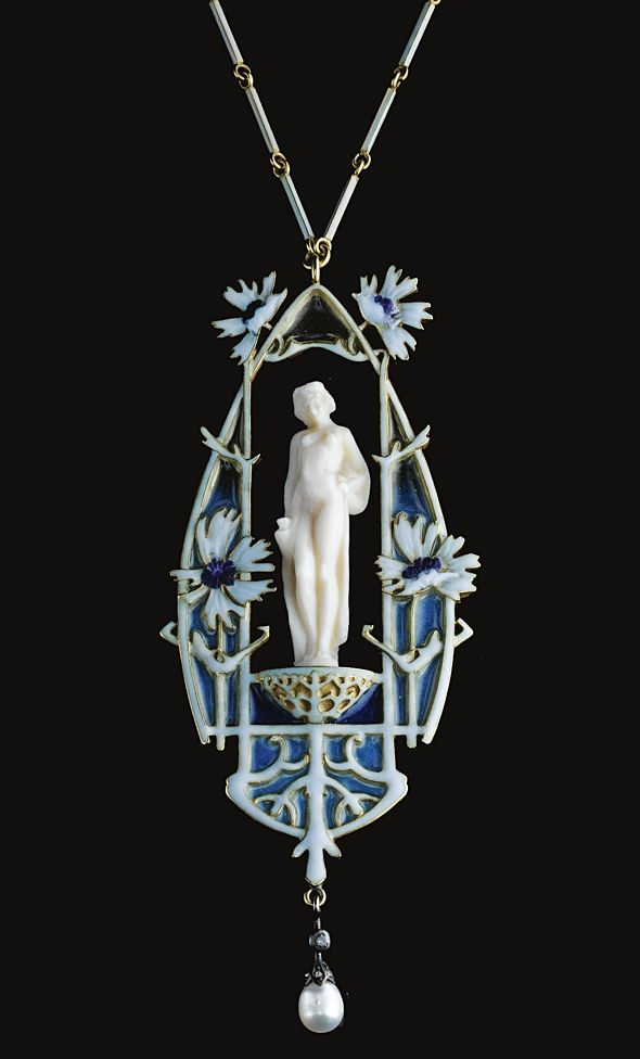 IVORY, ENAMEL AND DIAMOND PENDENT NECKLACE, RENÉ LALIQUE, CIRCA 1906. The central carved ivory female figure set within a frame of polychrome enamel in shades of blue and lavender, decorated with floral motifs, supporting a baroque cultured pearl drop surmounted with rose and single-cut diamonds, on a chain of enamelled baton-shaped links, length approximately 465mm, pendant signed Lalique.
