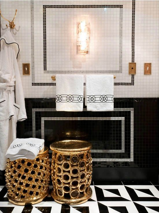 Black,white and gold in a bath is anything but simple! Love the varied pattern and texture in this bathroom!: