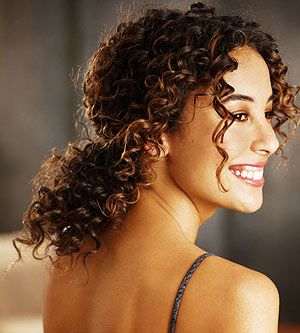Woman with brown curly hari