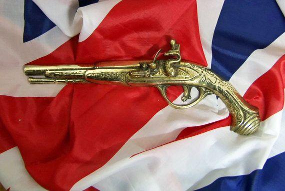 Striking solid cast brass flintlock pistol wall by RAVERETRO, £22.00