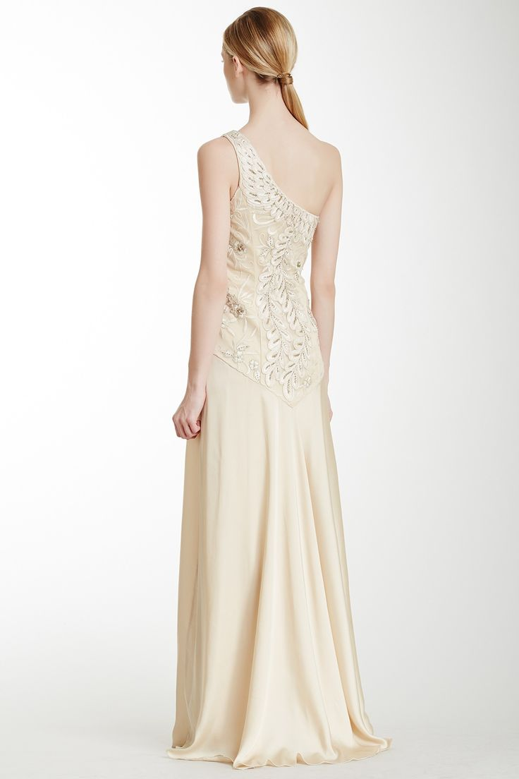 """One Shoulder Embellished Gown in antique champagne by Sue Wong $509 - $180 @HauteLook. [back] - One shoulder - Side zip and hook closure - Padded bust - Embellished bodice with mesh trim - Contrast skirt - Lined - 62"""" length. Model's stats: - Height: 5'9"""" - Bust: 34"""" - Waist: 23"""" - Hips: 35"""". Model is wearing size 4. Professional spot clean. Shell: 50% polyester, 50% nylon. Lining: 100% polyester."""
