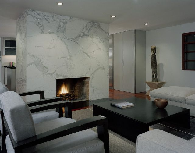 Marble. The quintessential modern living room would not be complete without a dramatic all-white Carrara marble fireplace.