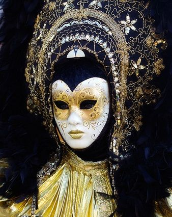 So stunning!  Black and gold with a white mask.  The headdress is magnificent.
