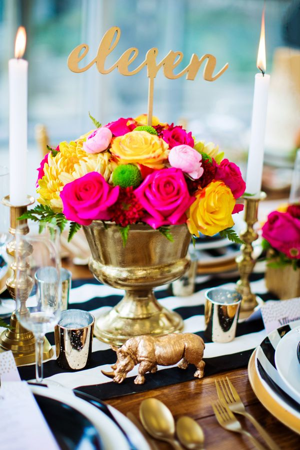 hot pink centerpiece - photo by Caroline Ross Photography http://ruffledblog.com/colorful-woodland-wedding-inspiration