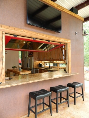Indoor Outdoor Kitchen. This gives guests a place to hang out, and be part of the action without being in the cooks way! It should also make the space feel bigger.