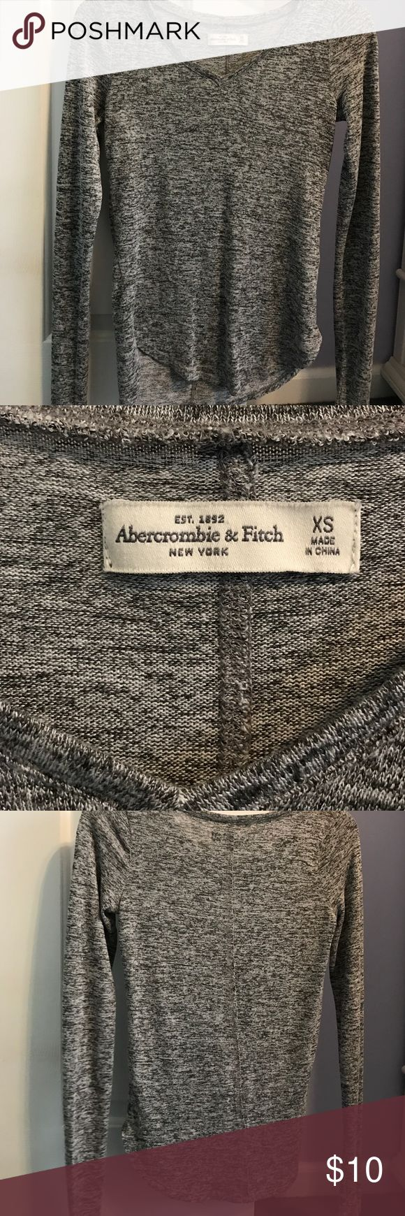 Abercrombie and fitch top Abercrombie and fitch heather grey top. V neck, fitted around chest area and arms, lose and flowing towards bottom. Xsmall size. Never worn, but no longer has tags. Abercrombie & Fitch Tops Tees - Long Sleeve
