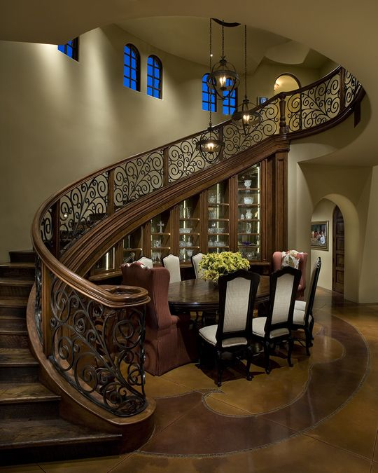 Design Of An Architectural Feature Integrates Both The Staircase And China Cabinet As One Strong