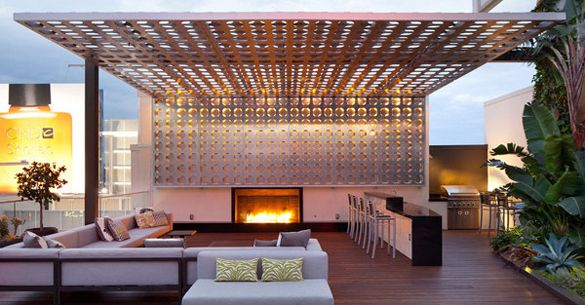 roof deck with shade lattice, bar & fireplace