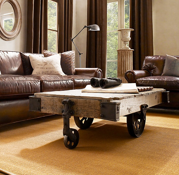 Reclaimed cart as coffee table from Restoration Hardware. Nice.