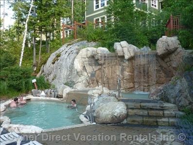 Spa and hot waterfall at this 3 bedroom condo in Tremblant Les Eaux, Mont Tremblant, Quebec with Scandinavian facilities.