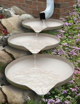 Wonder if old pie tins would work for this?  Great idea for gutter downspout in front flower beds :)    A potential attractive problem solver. Cascading dishes provide a unique replacement to conventional splash blocks at the bottom of downspouts. When placed under the downspout, they look like a beautiful garden fountain with the gentle sound of a waterfall when it rains.