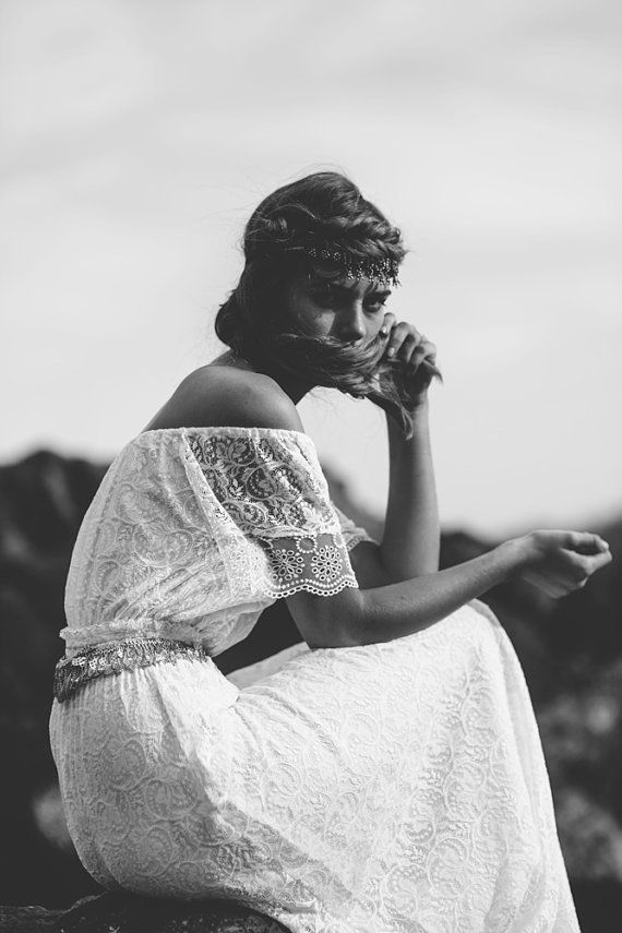 Gypsy boho white lace wedding dress with off the shoulder detail and stunning shape