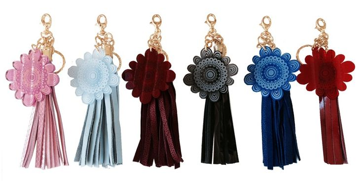 Designed to complement the 'Florens' collection, these charming tassel and Jacinta Lepoutre acrylic flower logo keychains, organises keys in style, and makes a decorative accent clipped to your Jacinta Lepoutre bag, wallet or clutch.Gold plated hardware and 2.2cm diameter split key ring attached.Available in six luxurious colours: Noir, rouge, electric blue, pink, pale blue and bordeaux.Noir - Noir patent leather with noir transparent acrylic JL flower logoRoug...