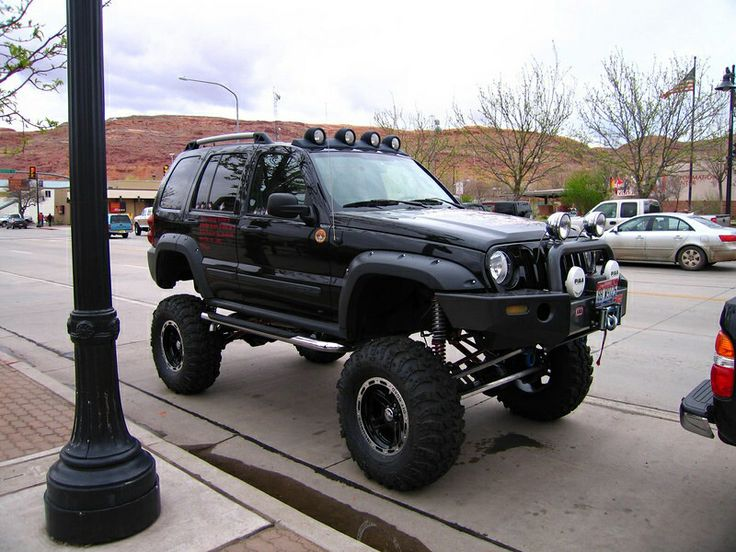 A lifted 2002 Jeep Liberty Sport with fog lights. I don't like it lifted, but I definitely want fog lights on mine.