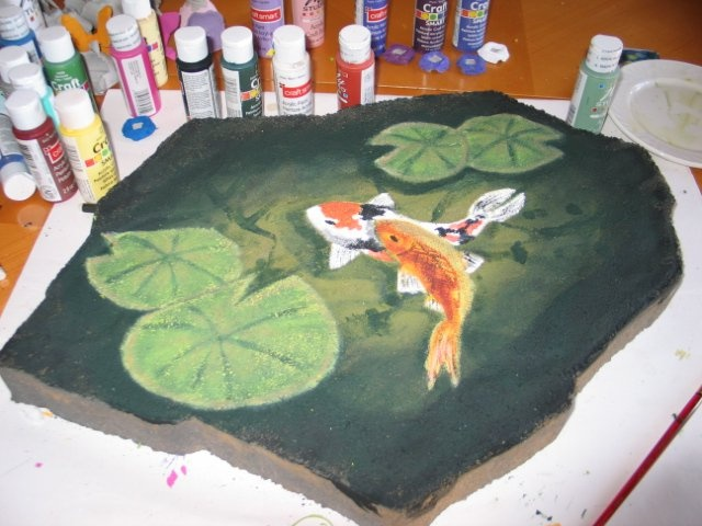 Stepping stone i painted to look like a koi pond i got for Koi fish pond for beginners