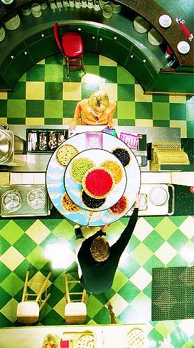 An example of how patterns, hyper-coloured settings and top-down perspectives were utilised in the series.