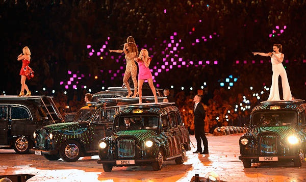 Fare enough ... The Spice Girls perform atop cabs at Olympic Stadium.
