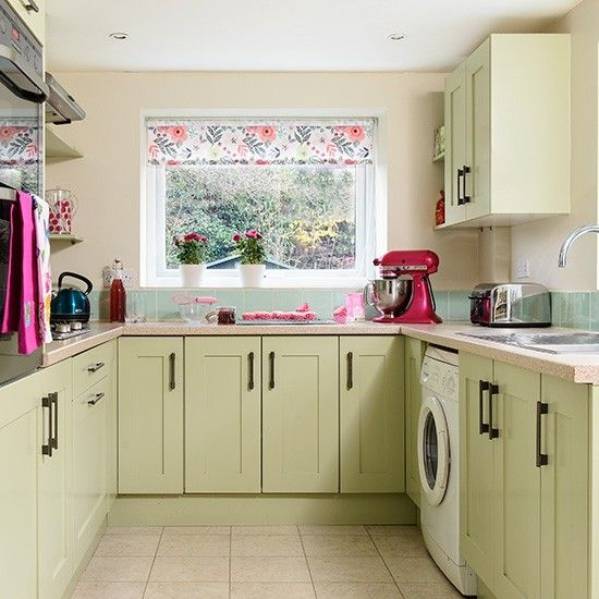 U shaped kitchen in country green with floral accents