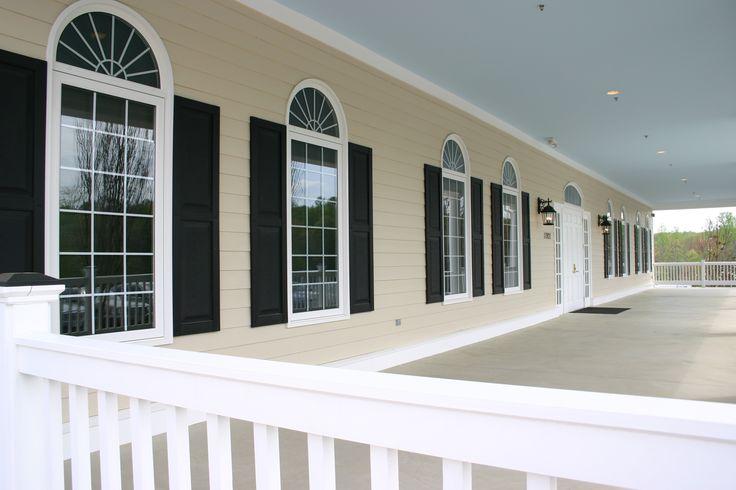 Colonial design casement windows with half round transom