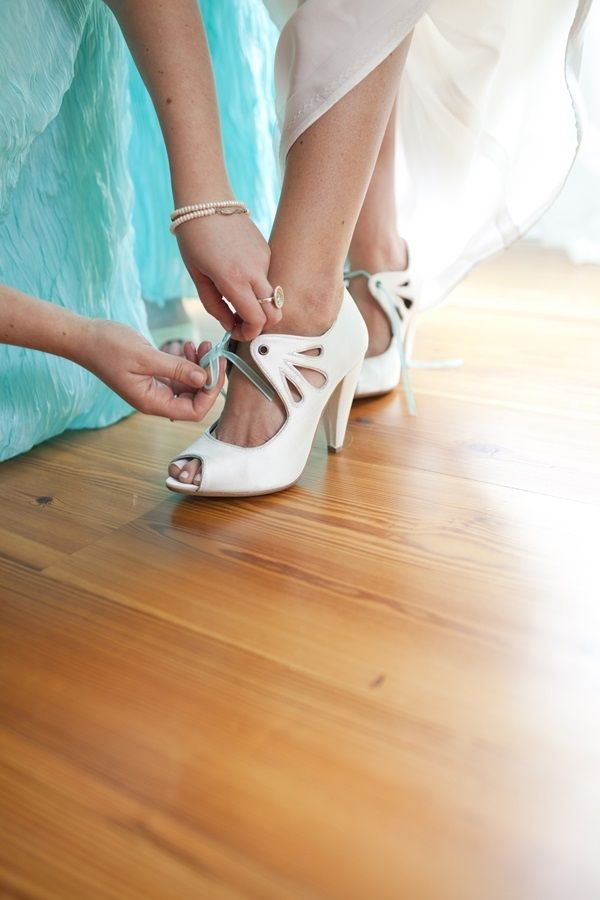 Vintage White Wedding Shoes With Aqua Ribbon Laces   photography by http://lauranegriphotography.com/