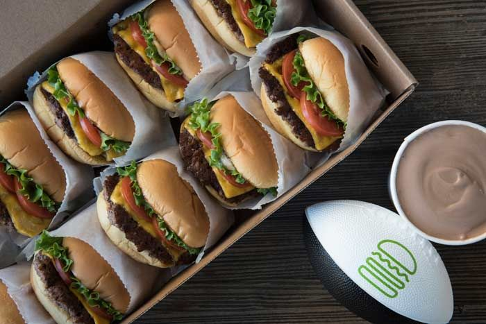 Catering and Decor To Go: For game-day catering, Shake Shack is offering the Big Game Shack Pack with 10 ShackBurgers, two pints of custard, and a piece of portable entertainment: a limited-edition Shake Shack mini football. The package is available for $50 at nearly all Shake Shack locations.