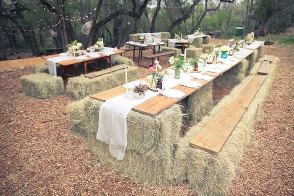 hay bale tables and chairs for a farm wedding