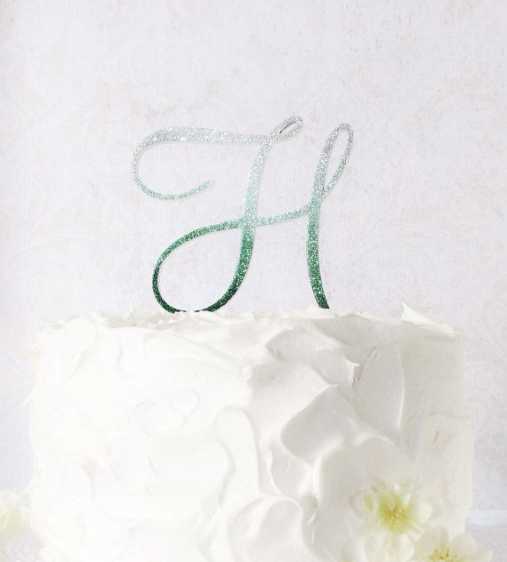 """Monogram wedding ombre cake topper 6"""" Luxe cake top by Studio Bloom Iowa-handmade wood monogram cake top features glam hand applied Ombre glitter and thick, high gloss finish for added shine & sparkle.  Shown in Greenland emerald green.   StudioBloomIowa, $105.00"""