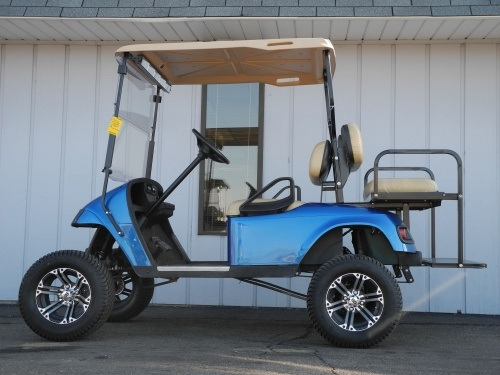 This custom 2008 E-Z-GO PDS electric golf cart is equipped with a 6-inch lift kit, custom blue body, folding windshield, standard hard top, rear view mirror, deluxe lights, rear flip seat, 12-inch alloy wheels, 23-inch tires, digital charge gauge, and Pyle stereo system.