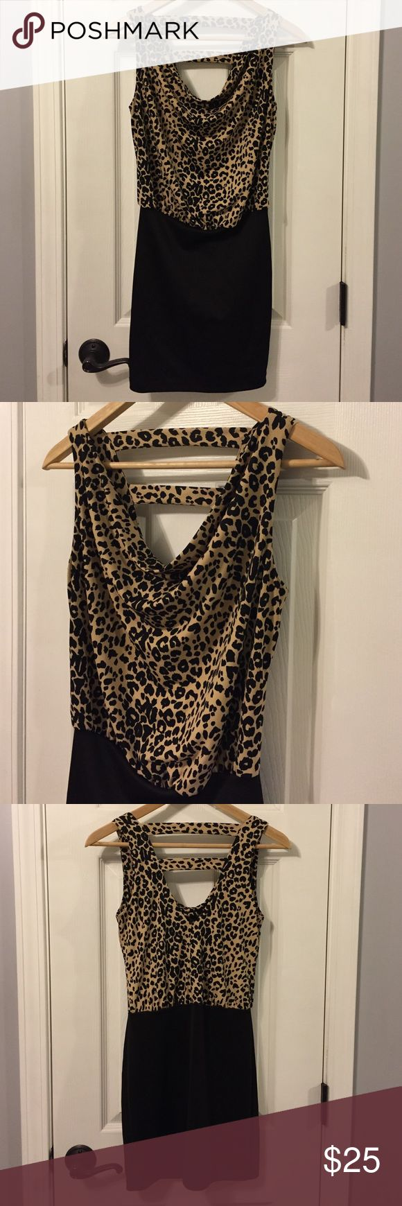 Animal Print & Black Dress This is a great dress for going out!! Very form fitting and fun! The front has a draped neck and the back is fairly open. 🎉Love the item but don't like the price? Make me a reasonable offer! 🎉 Body Central Dresses
