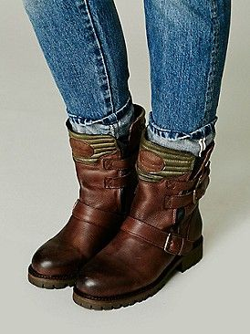 brown boots w/ tucked-rolled jeans