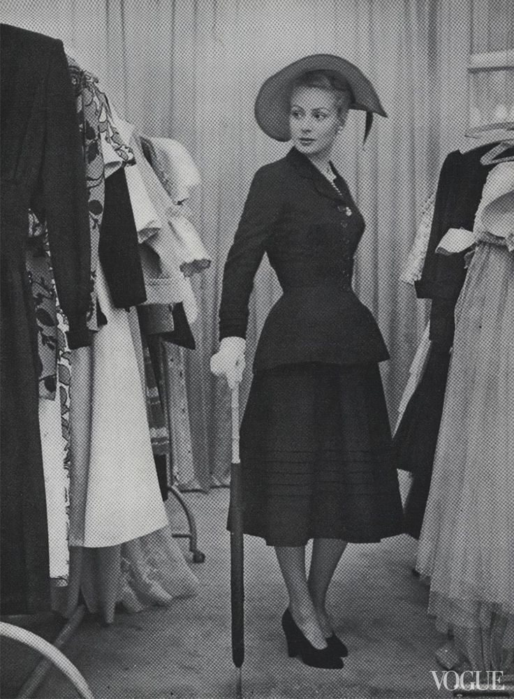 Among the racks, chez Dior. Photographed by Serge Balkin, Vogue, April 1, 1947