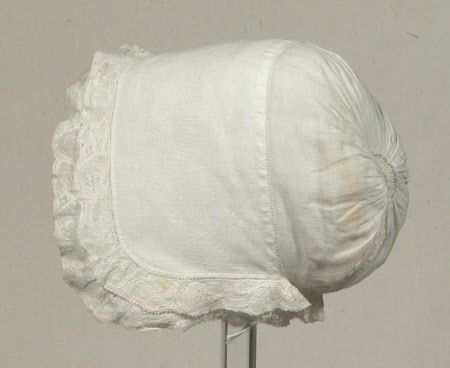 Cap, 18th century. Fine white linen with a brim impressed with stem and leaf design edged with fine Valenciennes lace.