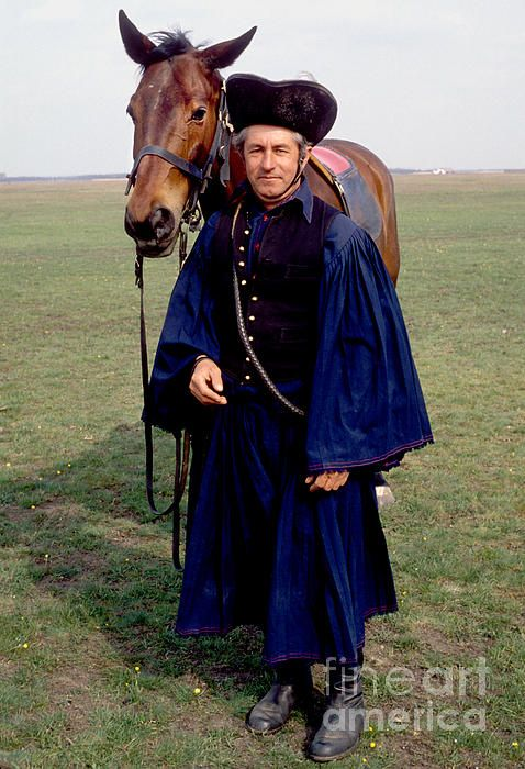 A traditional horseman or csikos with his horse on the plains in Hungary. For more information and prints click image.