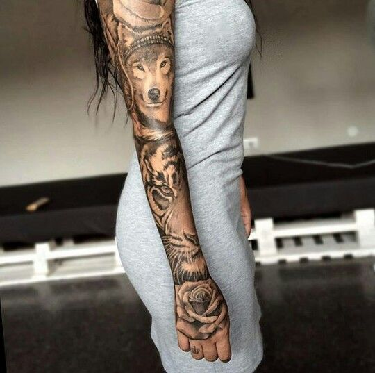 Wolf, tiger, rose... I don't think I could ever do it, but it's such a beautiful sleeve!