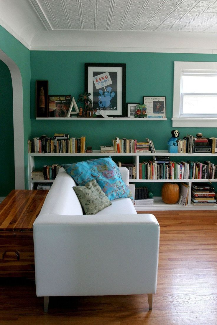 Great room: floors, wall color, white cove molding and ceiling. Low bookshelves across entire wall.