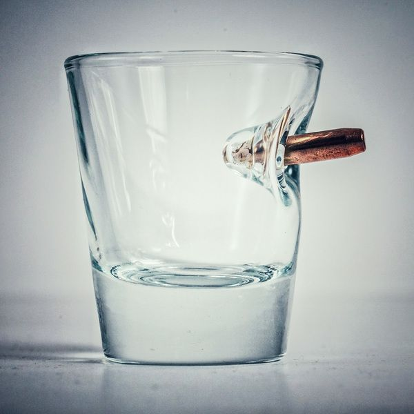 Just when I thought the wonderful world of whiskey couldn't get any better, I found this amazing glass to drink it out of. Complete with a real bullet. This killer piece (ha) is handmade with a ...