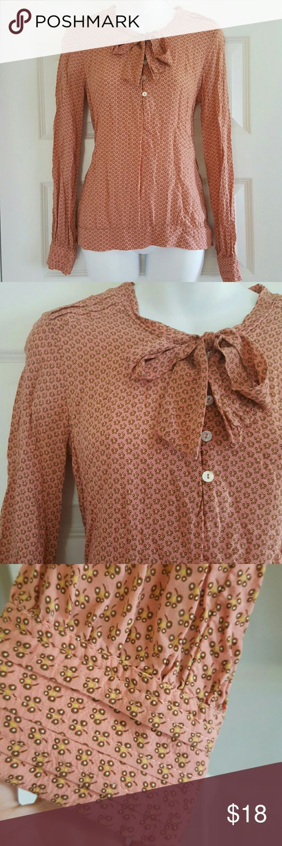 Grain de Malice Blouse - French Boutique Super, super cute blouse from the French boutique Grain de Malice.  Ties in the front.  Back of the bottom part of the shirt is made with stretchy material.  French size 38, US women's medium/size 8. Grain de Malice Tops Blouses