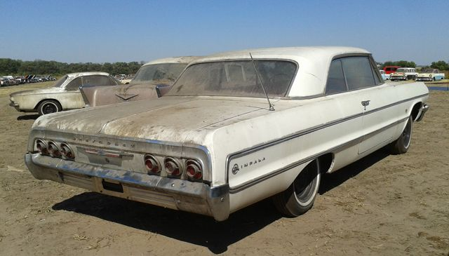 old rusty impalas for sale in davie county | Through the front window of Lamb  recht Chevrolet Co., this 1964 Impala ...