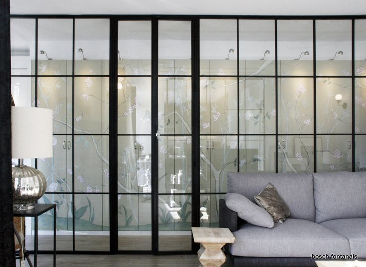Complete Renovation of a Penthouse into an Open Space Loft with Black Steel framed Glass Partitions.