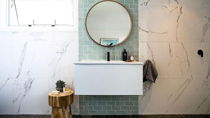 Bathroom Vanities that are practical and so pretty. Bathroom designed by Three Birds Renovations  (threebirdsrenovations.com).