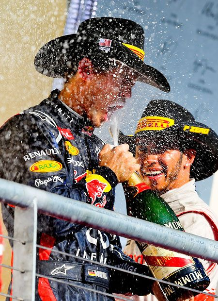 Winner Lewis Hamilton of McLaren Mercedes and second placed Sebastian Vettel of Red Bull Racing celebrate after the Grand Prix of US at the Circuit of the Americas in Austin, Texas