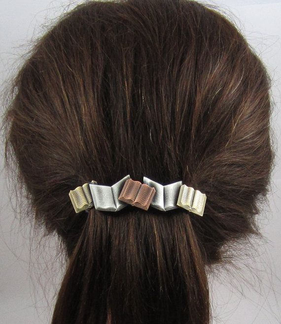 Five colorful books with beautiful detail form this wonderful sleek barrette. Soldered together and atop the genuine 80mm French Barrette